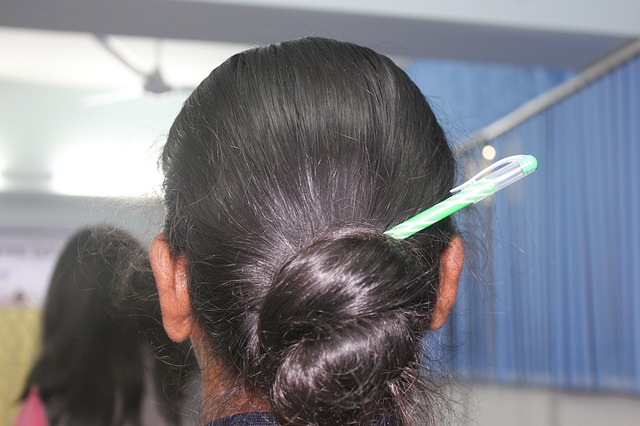 Woman with pen in her bun