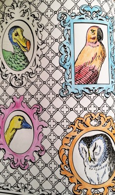 Photo of partially coloured in page of Alice in Wonderland colouring book