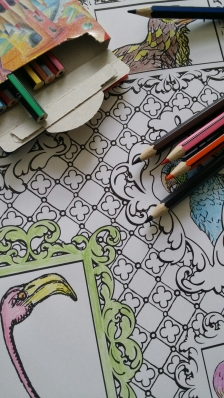 Photo of part coloured in page of Alice in Wonderland colouring book